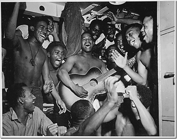 sailors abourd the USS Ticonderoga (CV-14) celebrate the surrender of japan