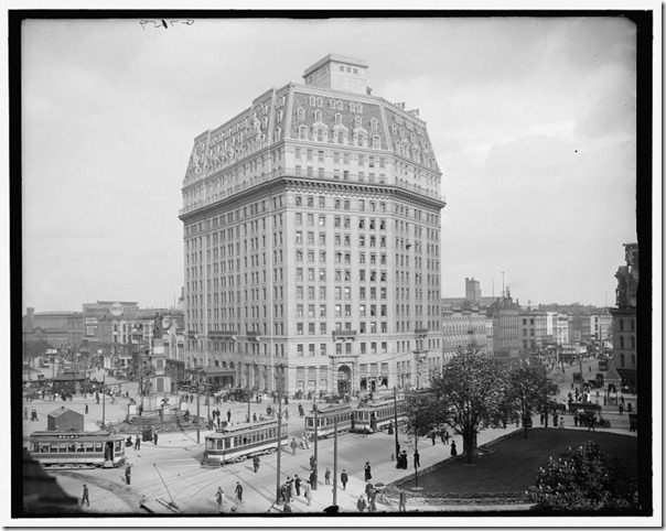 the-hotel-a-majestic-look-at-the-hotel-pontchartrain-with-a-glorious-view-of-a-set-of-trolley-cars-and-a-lush-green-park